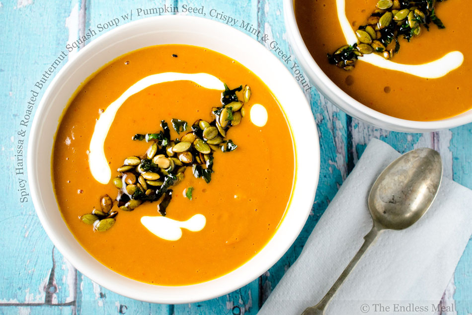 Spicy Harissa and Roasted Butternut Squash Soup with Pumpkin Seed, Crispy Mint and Greek Yogurt