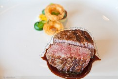 A10 Wagyu Steak with Yukon Gold Potato Latke, Crispy Cipollini Onion Rings, Watercress and Steak Sauce