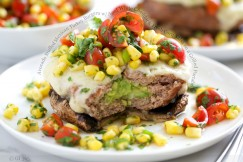 Avocado Stuffed Mexican Turkey Burgers with Aged White Cheddar and Fresh Corn Salsa on a Grilled Portobello Mushroom