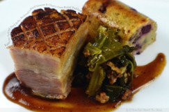 Barbecue Spiced Pork Belly, Braised Collard Greens and Cherry Corn Bread Pudding