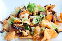 Bbq Kettle Chip Nachos with Roasted Pork, Queso, Bbq Sauce and Lettuce