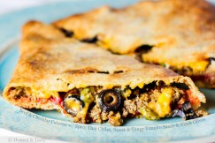 Beef & Cheddar Calzone with Spicy Thai Chiles, Sweet and Tangy Tomato Sauce and Black Olives