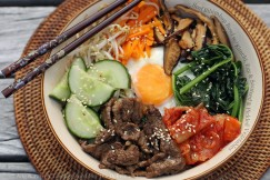 Beef Bibimbap Bowl with Kimchi, Egg and Sauteed and Pickled Vegetables