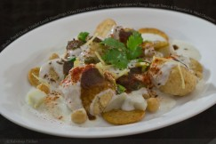 Bhalla Papdi Chaat- Tender Lentil Dumplings, Crisp Fried Wafers, Chickpeas and Potatoes with Tangy Yogurt Sauce and Tamarind and Mint Chutneys