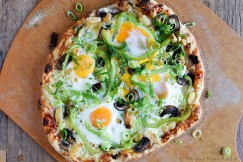 Breakfast Pizza with Eggs, Smoked Gouda, Roasted Garlic, Mushrooms, Peppers and Scallions