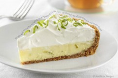 Bright Key Lime Pie with Whipped Cream and Lime Zest on Buttery Graham Cracker-Almond Crust