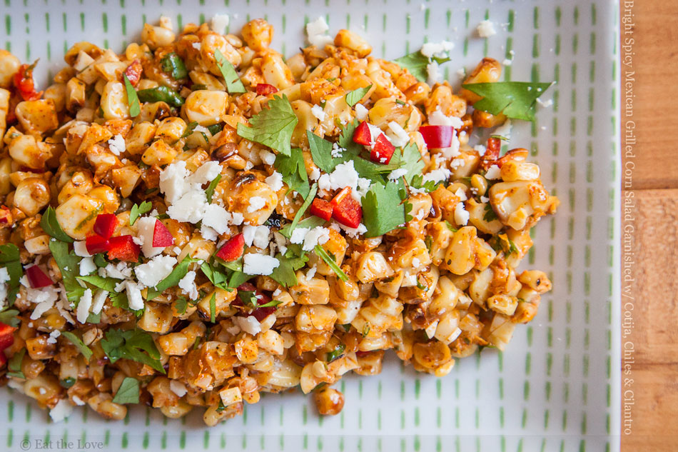 Bright Spicy Mexican Grilled Corn Salad Garnished with Cotija, Chiles and Cilantro
