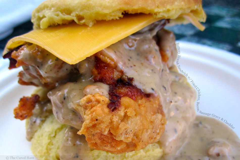 Buttery Biscuit Sandwich with Fried Chicken, Bacon, Sausage Gravy and Cheddar