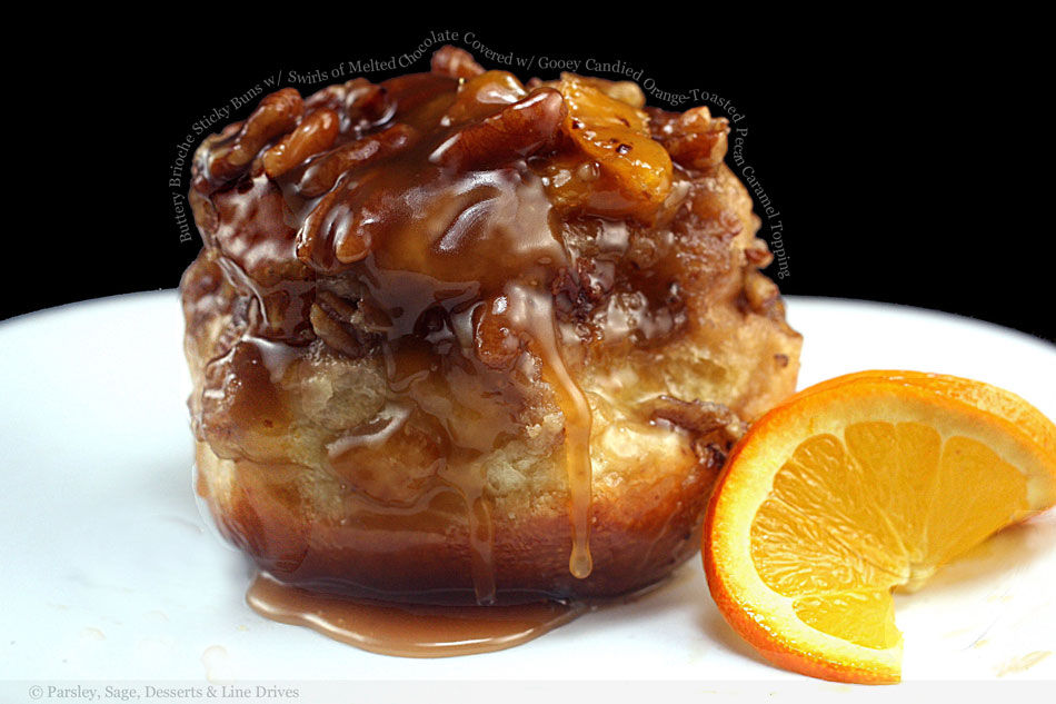 Buttery Brioche Sticky Buns with Swirls of Melted Chocolate Covered with Gooey Candied Orange-Toasted Pecan Caramel Topping