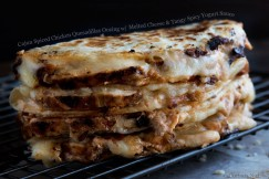 Cajun Spiced Chicken Quesadillas Oozing with Melted Cheese and Tangy Spicy Yogurt Sauce