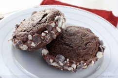 Cakey Chocolate Whoopie Pies Filled with Chocolate Malt Frosting Rolled in Crushed Malted Milk Balls