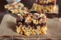 Caramel Rice Crispy Treats Topped with Chocolate and Snickers Bits