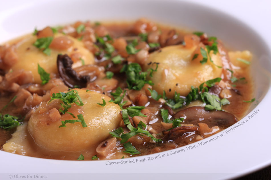 Cheese-Stuffed Fresh Ravioli in a Garlicky White Wine Sauce with Portobellos and Parsley
