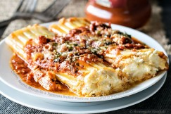 Cheesy Ricotta, Mozzarella and Parmesan Stuffed Manicotti Smothered in Marinara Sauce