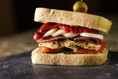 Chicken and Salami Sandwich with Roasted Red Pepper, Hard Boiled Egg, Pickles and Tomato