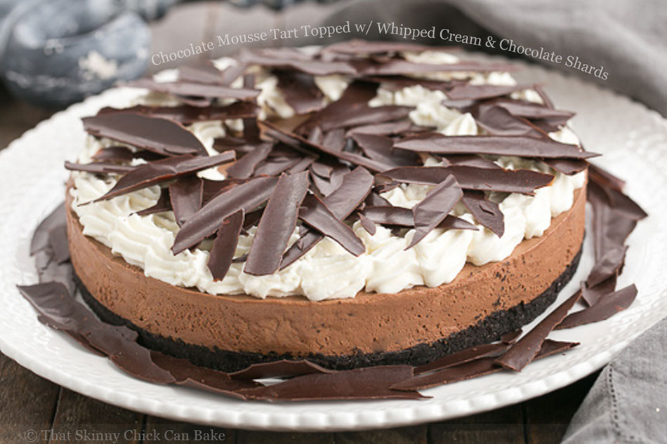 Chocolate Mousse Tart Topped with Whipped Cream and Chocolate Shards