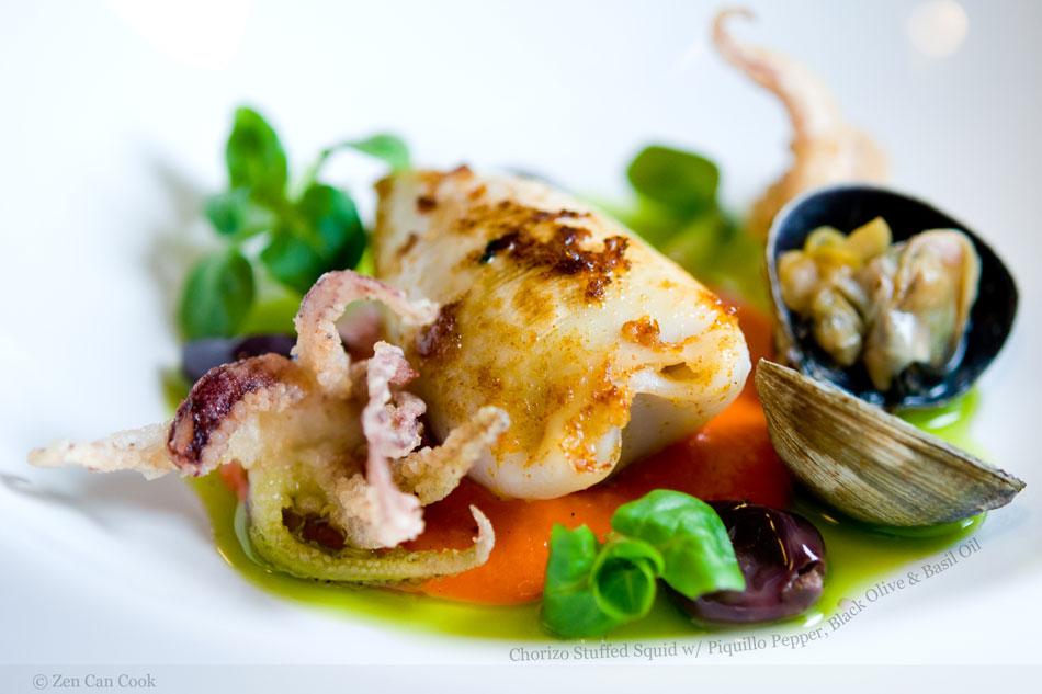 Chorizo Stuffed Squid with Piquillo Pepper, Black Olive & Basil Oil