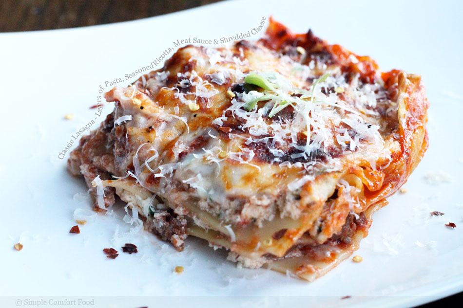 Classic Lasagna – Layers of Pasta, Seasoned Ricotta, Meat Sauce and Shredded Cheese