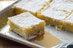 Classic Tart Lemon Bars on Buttery Shortbread with Powdered Sugar