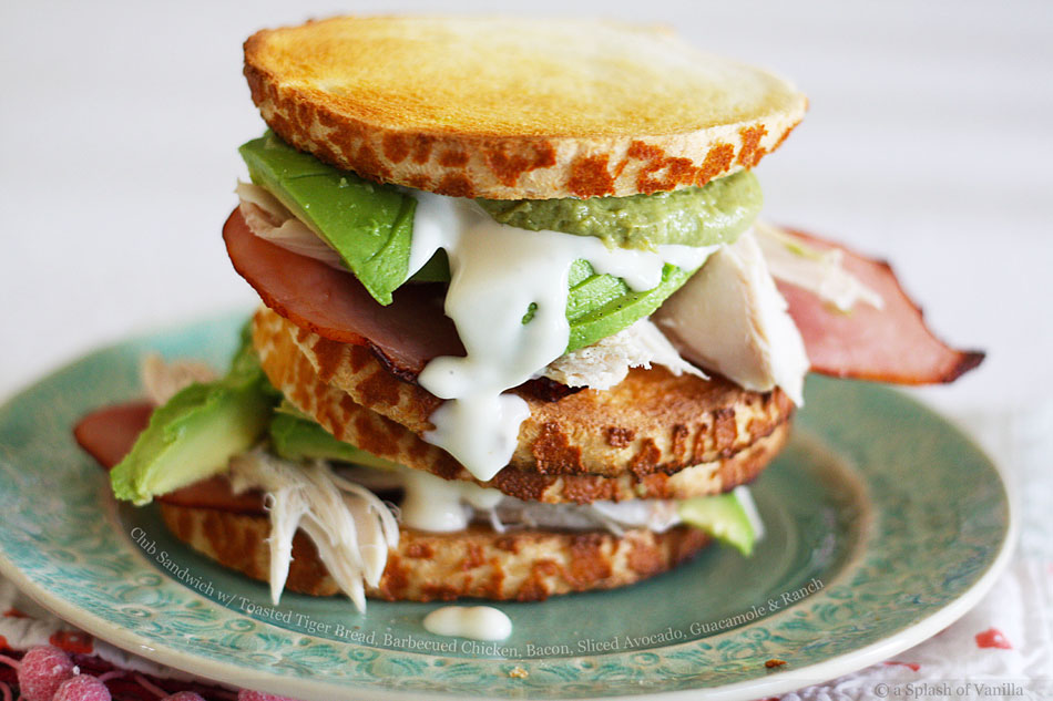 Club Sandwich with Toasted Tiger Bread, Barbecued Chicken, Bacon, Sliced Avocado, Guacamole and Ranch