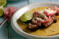 Coffee-Rubbed Steak Tacos with Pickled Red Onion, Cotija and Lime on Corn Tortillas