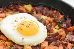 Corned Beef Hash with Sweet Potatoes, Onion, Turnip, Mustard and Thyme Topped with a Sunny Side-Up Egg