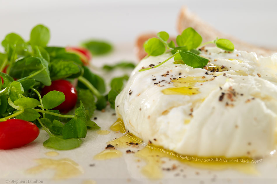 Creamy Burrata Drizzled with Olive Oil and Sprinkled with Sea Salt and Cracked Black Pepper