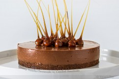 Creamy Nutella Cheesecake with Candied Hazelnuts