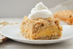 Creamy Pumpkin Cheesecake Bars with a Crumb Crust and Whipped Cream