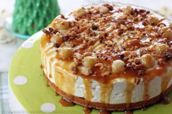 Creamy White Chocolate Macadamia Cheesecake Drenched in Caramel Sauce