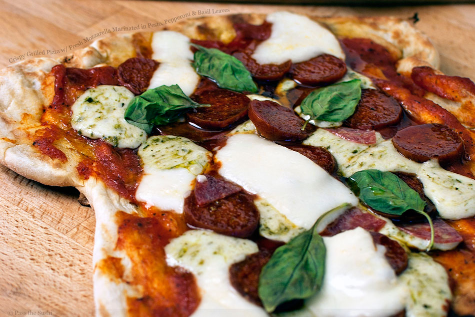 Crispy Grilled Pizza w/ Fresh Mozzarella Marinated in Pesto, Pepperoni & Basil Leaves
