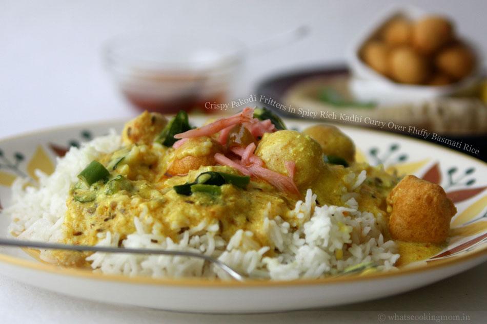 Crispy Pakodi Fritters in Spicy Rich Kadhi Curry Over Fluffy Basmati Rice