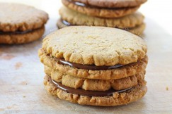 Crispy Peanut Butter Cookie Sandwiches Filled with Peanut Butter Chocolate Ganache