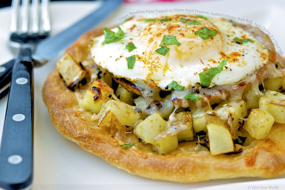 Crispy Breakfast Pizza Topped with Home-Fried Potatoes, Sauteed Onions, Pork Roll, Jack Cheese and a Fried Egg
