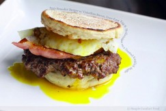 Eggs Benedict Burger with Canadian Bacon, Over-Easy Egg and Hollandaise on a Toasted English Muffin