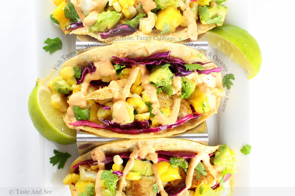 Fish Tacos with Mango Guacamole, Tangy Cabbage, Sweet Corn, and Creamy Chipotle Sauce