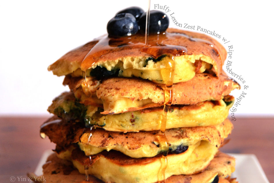 Fluffy Lemon Zest Pancakes with Ripe Blueberries and Maple Syrup