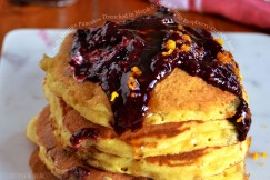 Fluffy Orange Pancakes Drenched in Maple Syrup and Tangy Raspberry-Orange Jam