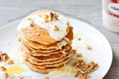 Fluffy Pancakes Loaded with Honey and Walnuts Topped with Double Cream