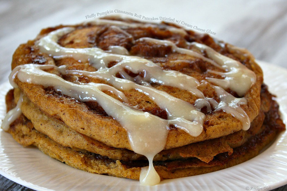 Fluffy Pumpkin Cinnamon Roll Pancakes Drizzled with Cream Cheese Glaze