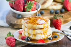 Fluffy Ricotta Pancakes Drenched in Maple Syrup