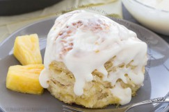 Fluffy Sweet Rolls Filled with Pineapple Curd and Smothered with Cream Cheese Frosting