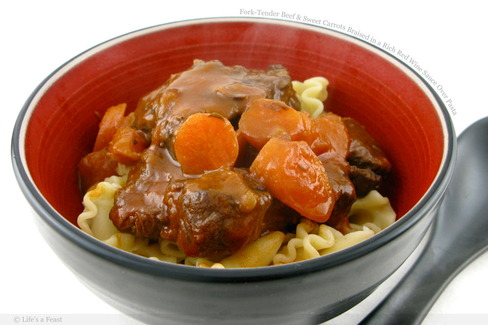 Fork-Tender Beef and Sweet Carrots Braised in a Rich Red Wine Sauce Over Pasta