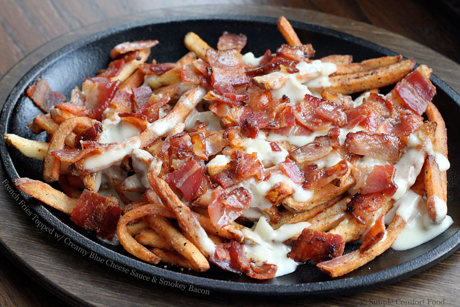 French Fries Topped with Creamy Blue Cheese Sauce and Smokey Bacon