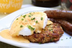 Golden Brown Zucchini Cakes with Poached Eggs, Bright Hollandaise Sauce and Sweet Maple Sausage
