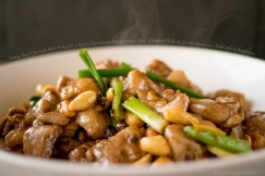 Gong Bao Chicken Stir-Fried in a Spicy Szechuan Peppercorn, Soy, Ginger, Chile and Garlic Sauce with Peanuts and Scallions