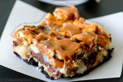 Gooey Cookie Bars with Oreo Crumbs, Chocolate Chips, Peanuts, Coconut, Pretzels and Caramel