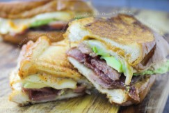 Grilled Brown Sugar Glazed Country Ham Sandwich with Peppered Avocado, Cheese and Roasted Tomato, Poblano and Garlic Mayo