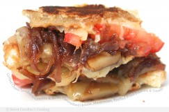 Grilled Cheese Loaded with Gruyere and  Swiss, Caramelized Onions, Mushrooms, Truffled Fried Potatoes and Tomato