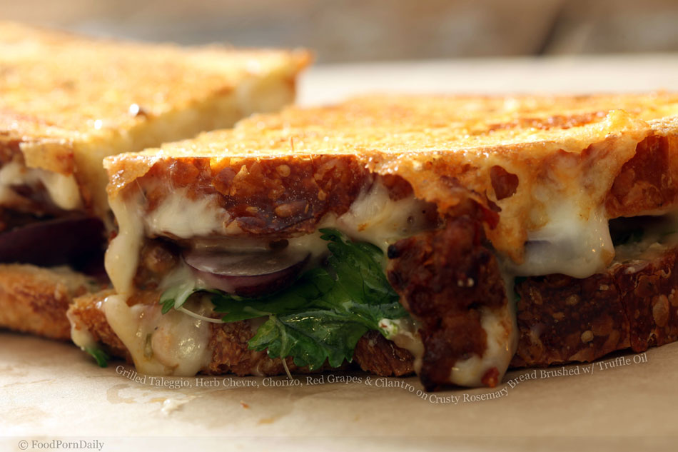 Grilled Taleggio, Herb Chevre, Chorizo, Red Grapes and Cilantro on Crusty Rosemary Bread Brushed with Truffle Oil